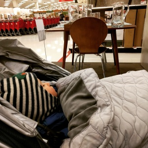 Asleep in the home furnishings area of Target. I was lounging on a display loveseat when I took this picture. One nap to rule them all.